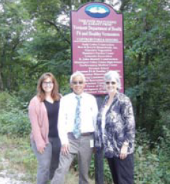 Dorey Myers, RN, public health nurse in St. Albans, stands before the completed Swanton Rail Trail with Commissioner of Health Harry Chen, MD and Judy Ashley-McLaughlin, director of the St. Albans District Health Office.